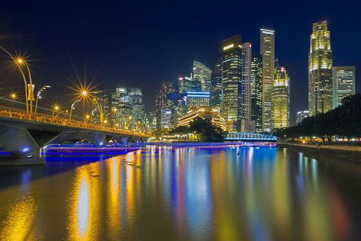 Cruise boats colouring Singapore river at sunset