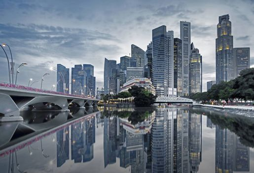 Singapore cityscape casting reflections in the early morning
