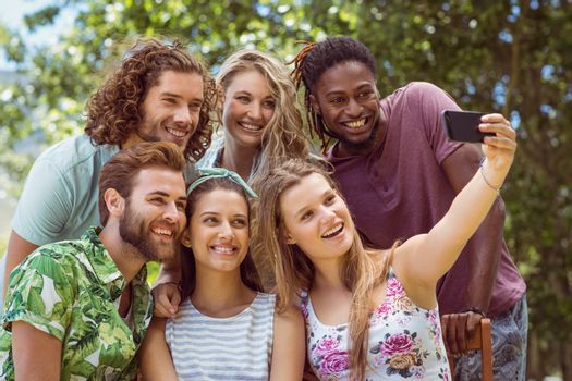 Happy friends taking a selfie on a summers day