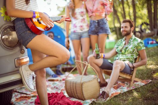 Hipsters having fun in their campsite