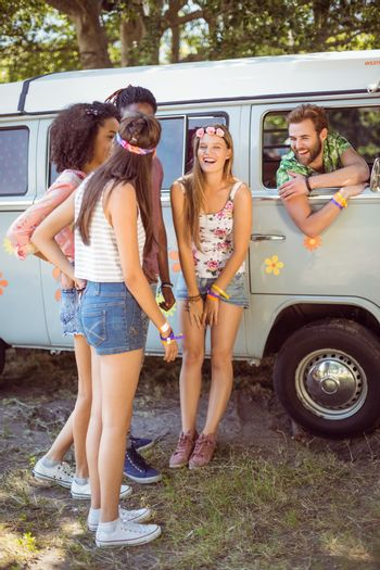 Hipsters hanging out by camper van