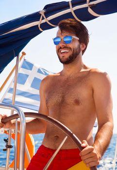 Sexy captain of sailboat