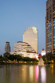 Twilight at Benjasiri Park in Bangkok.