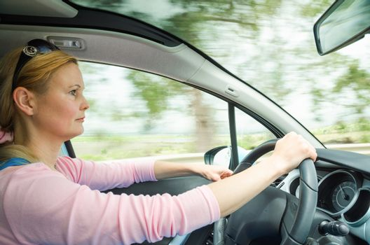Profile portrait of serious calm woman carefullly safe driving c