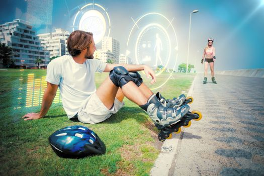 Composite image of fit man getting ready to roller blade