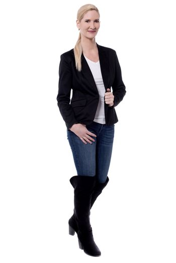 Fashionable woman in boots.