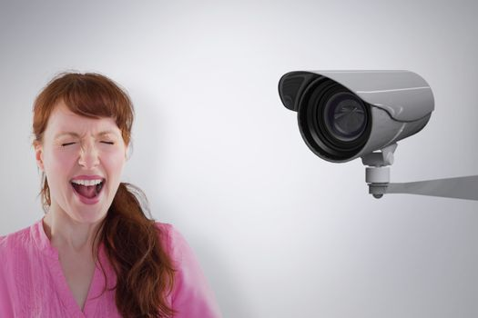 Composite image of woman shouting towards the camera