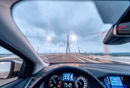 Crossing the bridge with a modern car, cockpit view