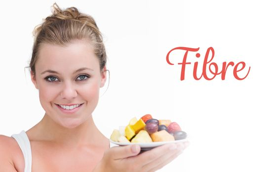Fibre against woman holding up a plate fruits