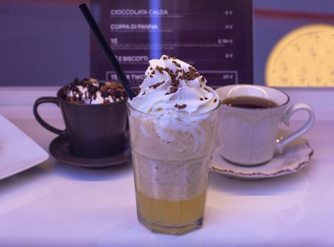 Close up of thickshake , chocolate cup and tea