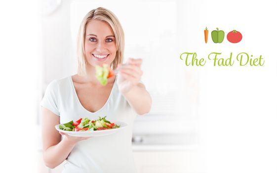 The fad diet against close up of a good looking woman eating salad