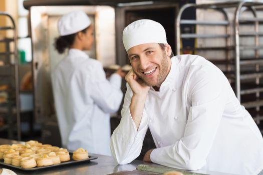 Baker smiling at the camera