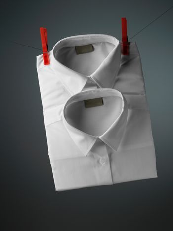 white shirt over gray background with pin