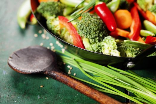 Chinese cuisine. Wok cooking vegetables.