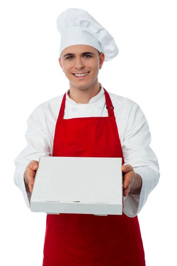 Young male chef delivering pizza