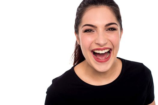 Young woman laughing loud