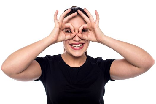 Cheerful woman in observe gesture