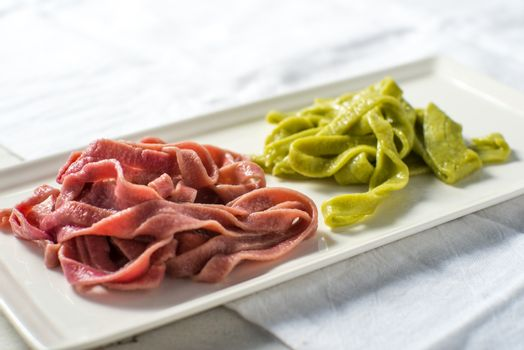 Homemade colorful pasta fettuccine made from vegetable juice