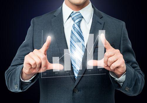 Businessman framing digital chart