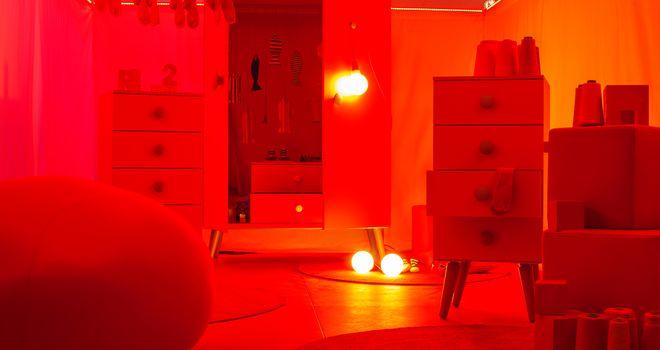 MILAN, ITALY - APRIL 16: View of red bedroom, Collegien pavilion at Tortona space location during Milan Design week on April 16, 2015