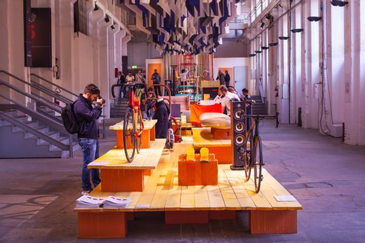 MILAN, ITALY - APRIL 16: People visit Fuorisalone at Tortona space location of important events during Milan Design week on April 16, 2015