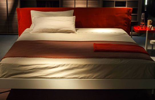 MILAN, ITALY - APRIL 16: View of Ermione bed design by Francesco Bettoni displayed at Tortona space location of important events during Milan Design week on April 16, 2015