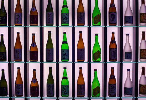MILAN, ITALY - APRIL 16: Japanese Sake bottles displayed at Tokyo design pavilion at Tortona space location of important events during Milan Design week on April 16, 2015