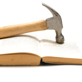 hammer with book
