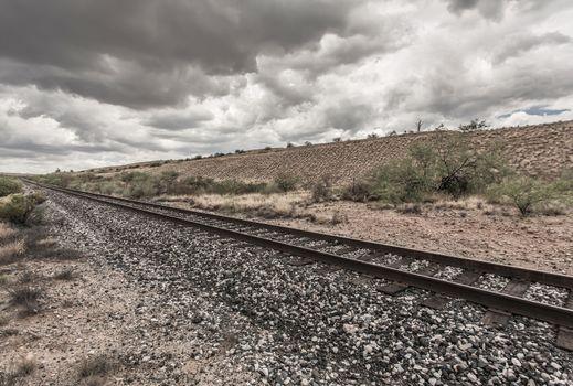 Line of Railroad Tracks in Desert