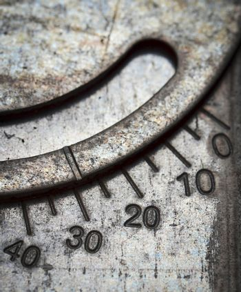 numerical scale on metal