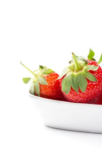Juicy ripe red home grown strawberries in a bowl
