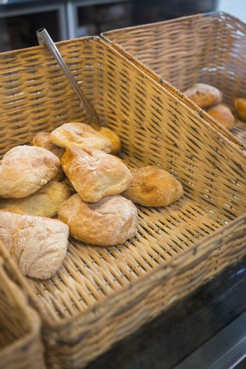 Baskets with delicious breads and tongs