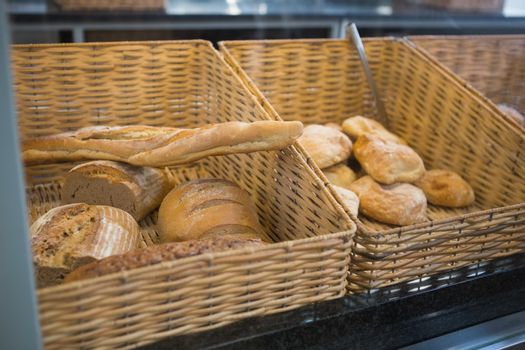 Baskets with breads freshly baked and tongs
