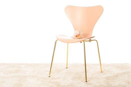 Stylish modern chair with a porcelain teacup