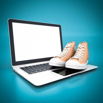 Fashion leather shoes and white laptop on a blue background