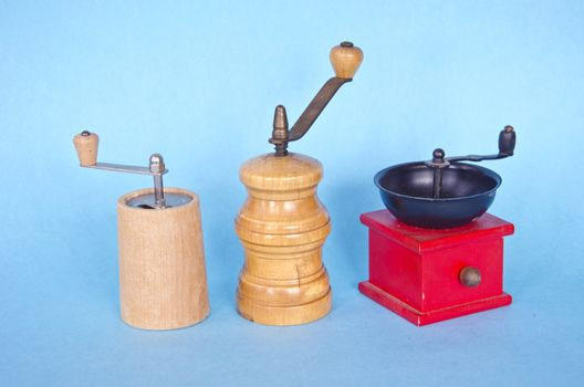 three spices pepper grinder on blue background