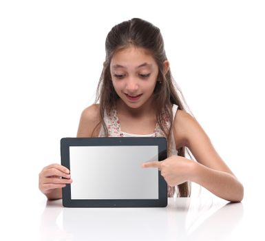 Beautiful pre-teen girl showing a tablet computer. Clipping path for the screen