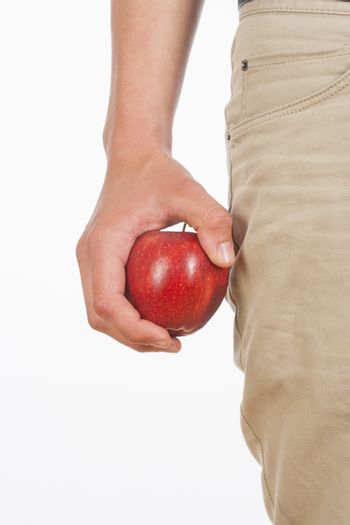 Hand Holding Red Apple Against White Background