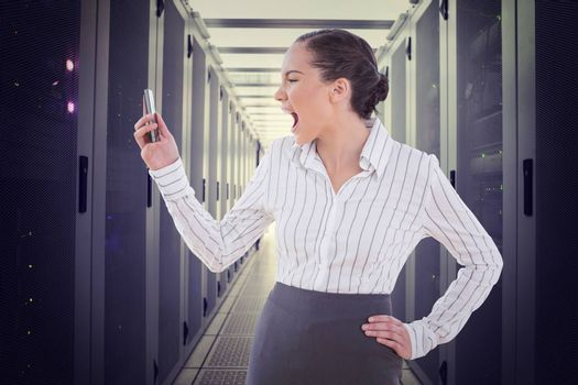 Angry businesswoman screaming at her phone against data center