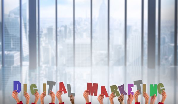Composite image of hands showing digital marketing