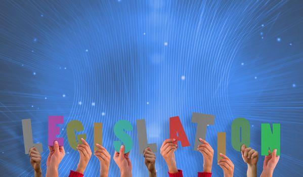 Composite image of hands holding up legislation