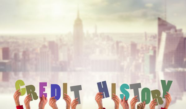 Composite image of hands holding up credit history