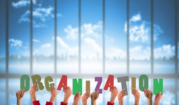 Composite image of hands holding up organization