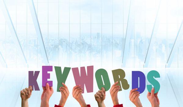 Composite image of hands showing keywords