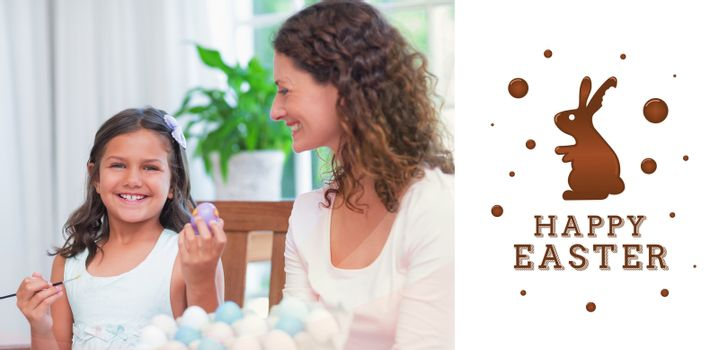 Happy mother and daughter painting easter eggs  against happy easter graphic