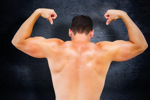 Attractive bodybuilder against black background