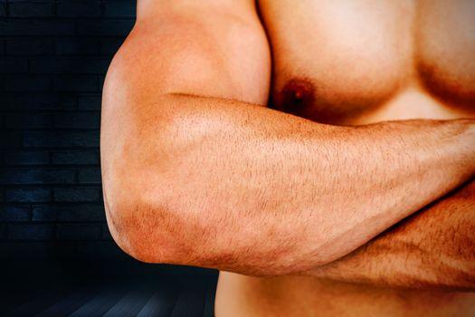 Bodybuilder  against black background