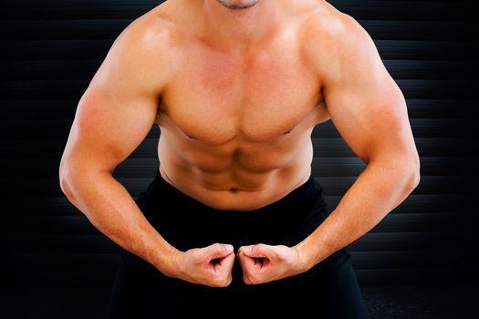 Bodybuilder flexing against black background