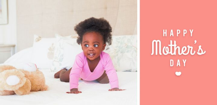 mothers day greeting against baby girl in pink babygro crawling on bed