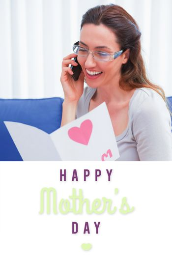 mothers day greeting against mother reading a lovely card on phone call